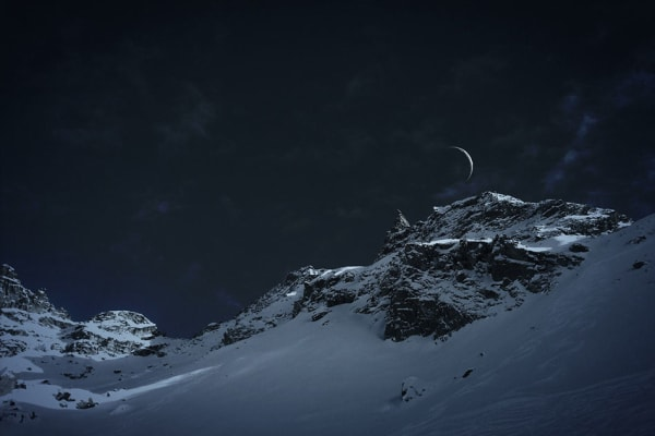 This stunning photo by Elena Grimailo shows the moon hanging just above a snowy mountain range. [Credit: Elena Grimailo/IPPA]