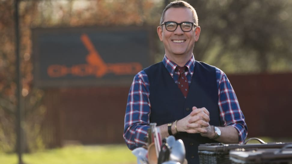 The host of Chopped smiling