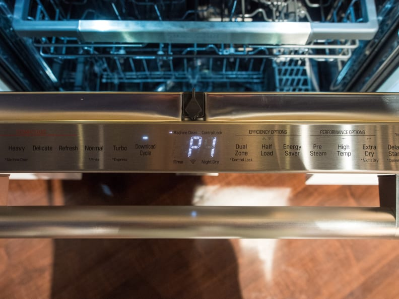 The UPDF9904ST dishwasher features a hidden control panel along the top of the door.