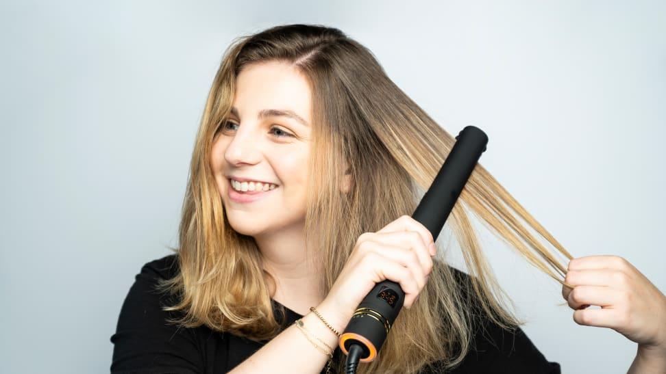 A woman using a hair straightener