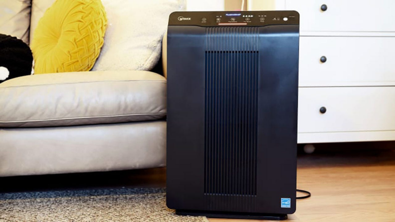 A Winix air purifier sits in a living room.