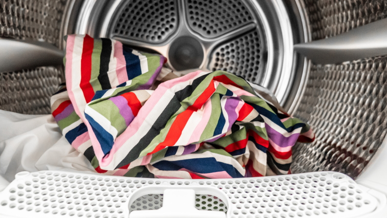 Colorful clothes inside of dryer drum