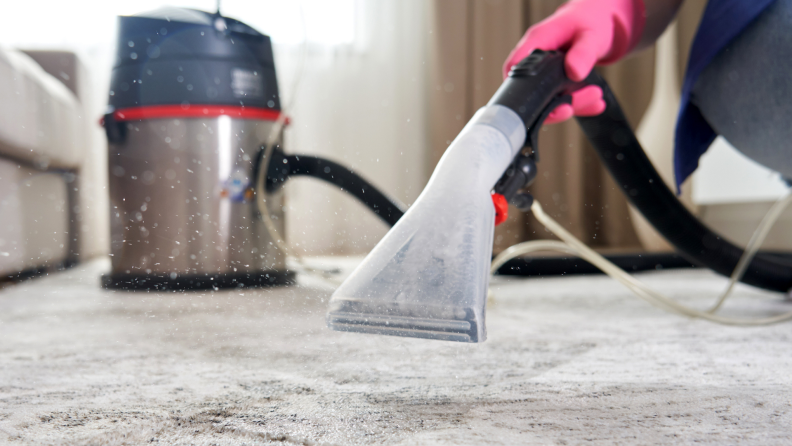 Person using carpet cleaner