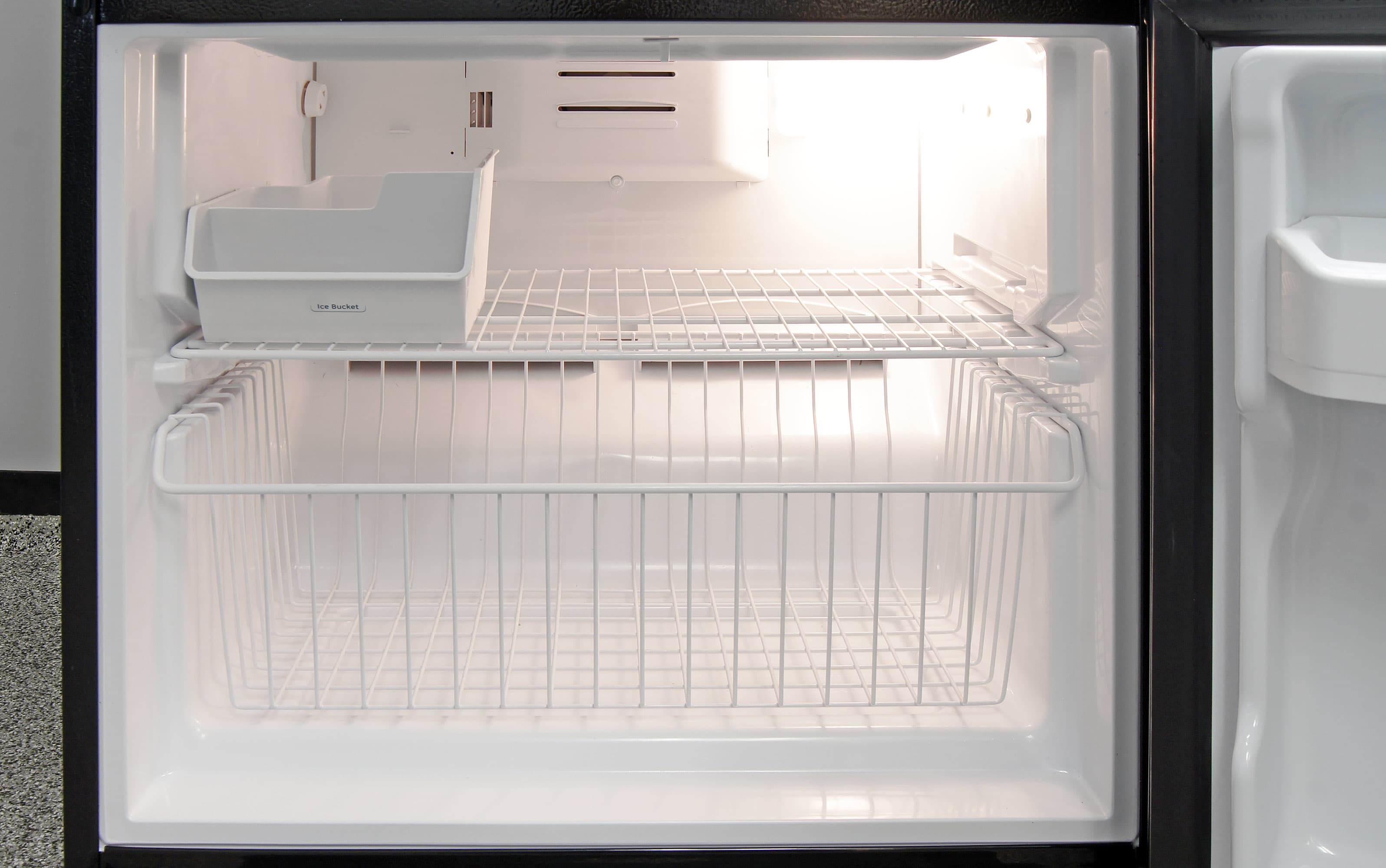 Even though the freezer comes with an optional ice bucket, the GE Artistry ABE20EGEBS has no interior icemaker of any kind.