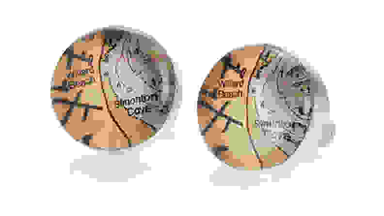 Cufflinks with maps on it.