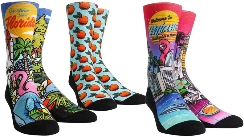 Three Florida-themed men's socks.