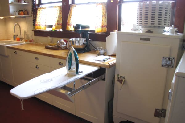 We don't know which we love more: the GE Monitor Top fridge or the built-in ironing board.