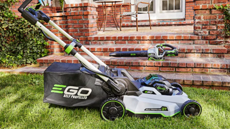 An Ego Power+ electric lawn mower sits on a lawn.