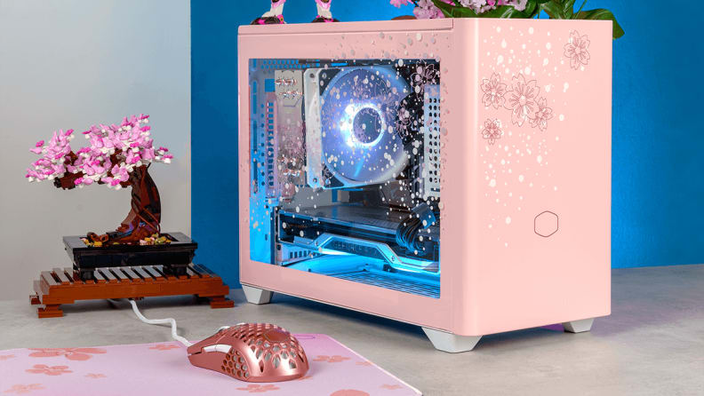 a pink PC on a desk with a pink mouse