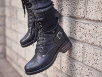 Crave boots from Taos dangling from a wall