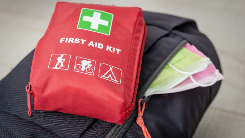 Close up of a backpack and first aid kit.