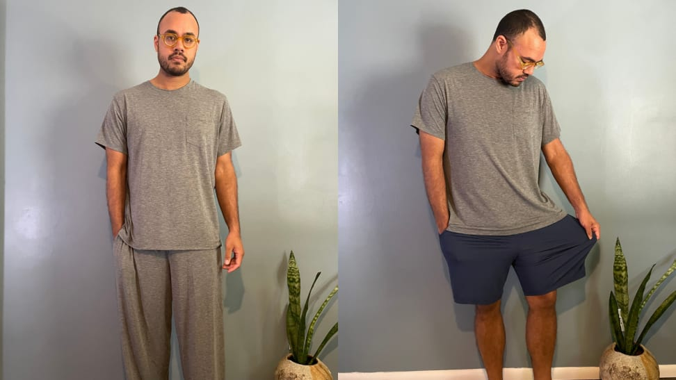 man standing in grey pajama set from Tommy John, man stretching blue pajama shorts by Tommy John