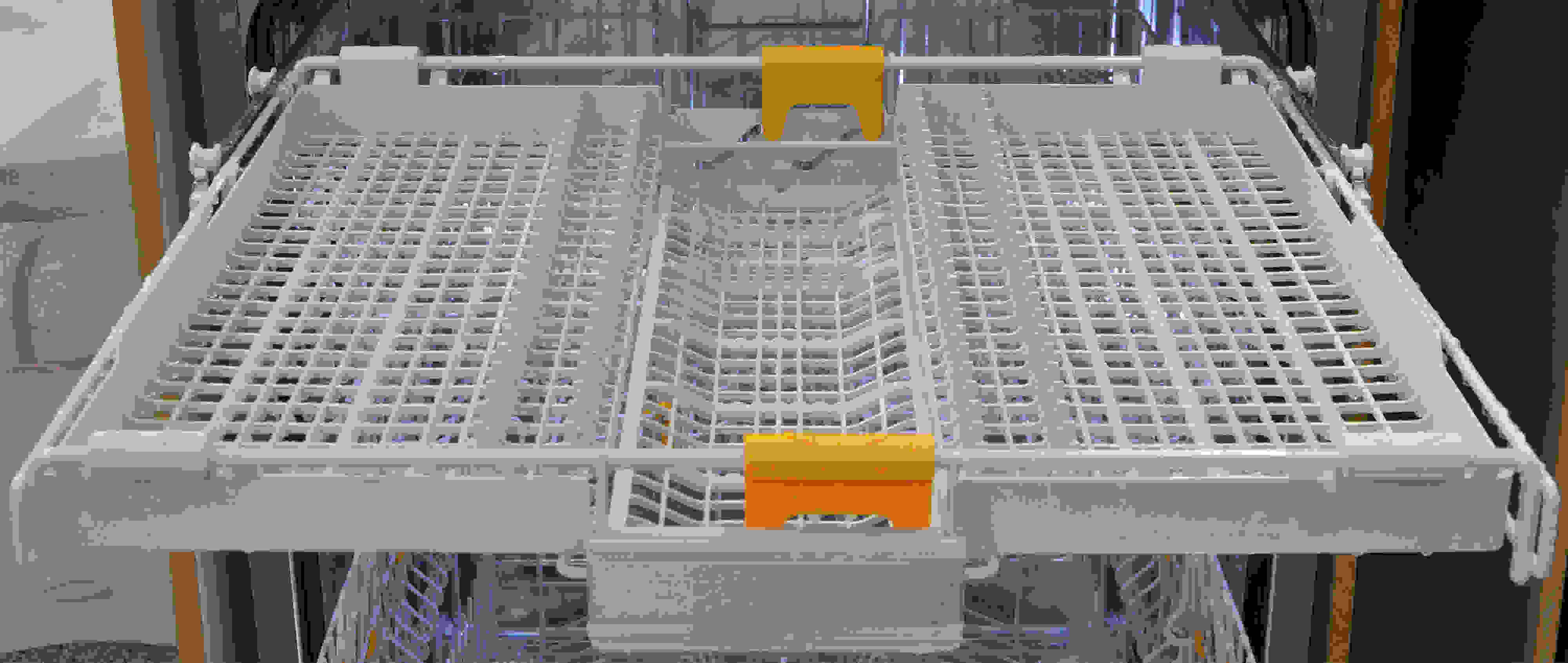 Showing the yellow sliders that adjust the third rack's middle section