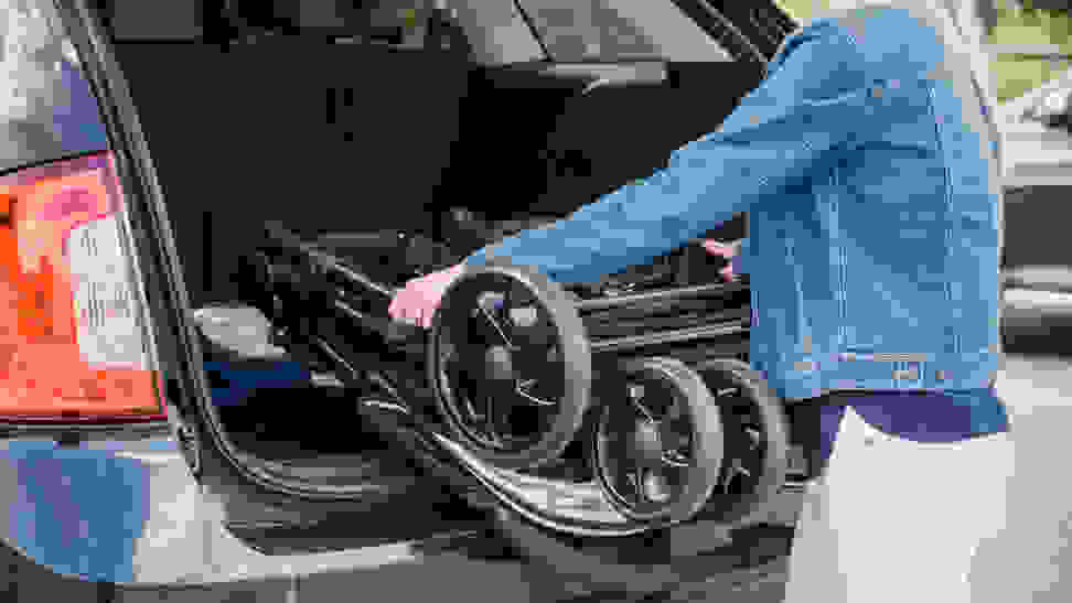 Taking a stroller out of a car trunk