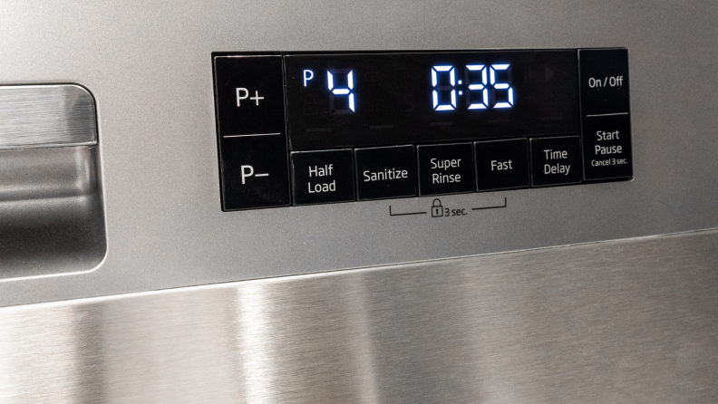 The front control panel of a stainless steel dishwasher has an LED light display