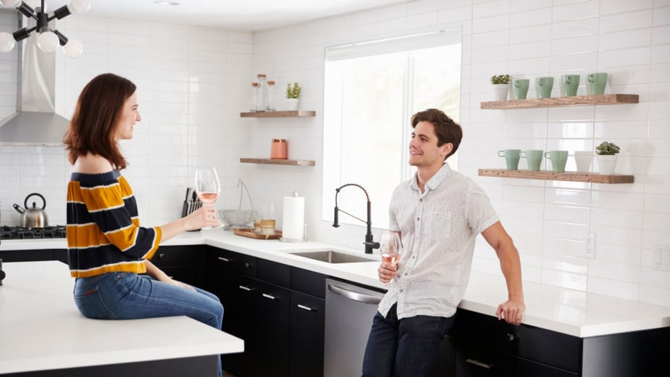 Couple in newly renovated kitchen