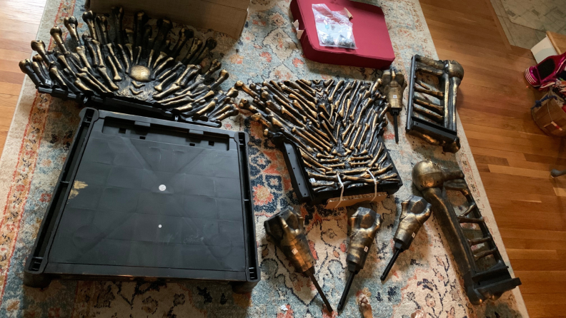 Pieces of Bone Throne chair on floor prior to assembly.