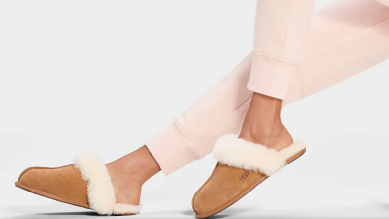 Woman wearing chestnut Ugg fur lined slippers