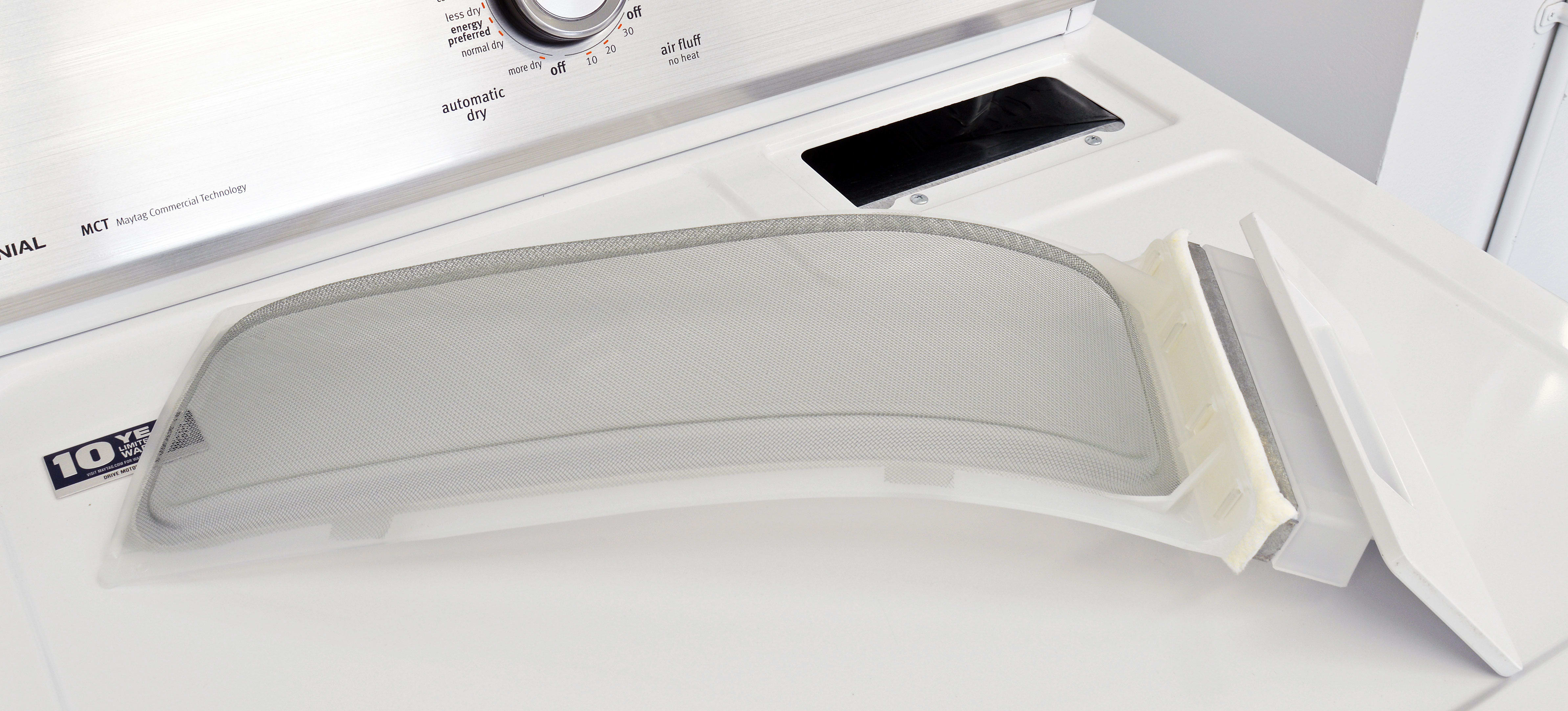 Pullout lint traps are still common on lower-end units like the Maytag Centennial MEDC215EW.