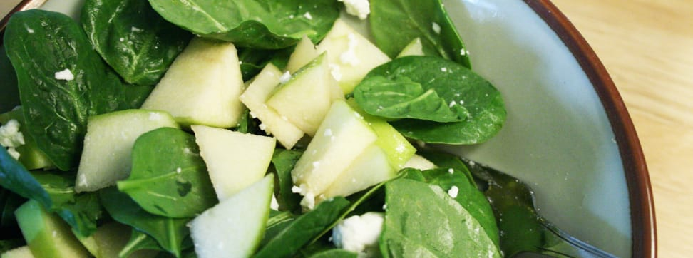Photo of a spinach and apple salad.