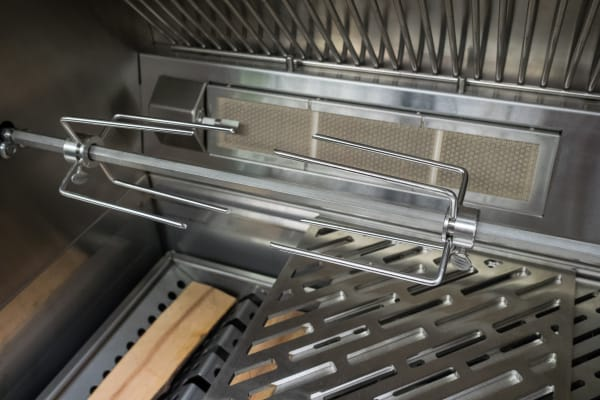 The gear-driven rotisserie comes standard on all Kalamazoo hybrid grills, as well as the Gaucho grill. It can handle up to 40 pounds of load.