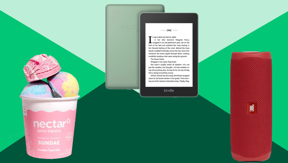 bath bombs, e-reader and red portable speaker on a green background