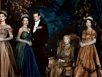 A still from the first series of The Crown featuring all the royals in gowns and suits.
