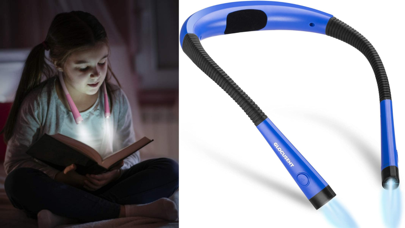 A child reads in the dark with a wearable reading lamp.