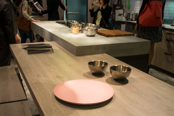 At least one of Snaidero's EuroCucina kitchens featured an overlapping combo of wood and stone.