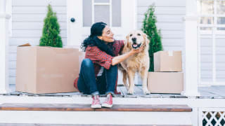 Woman moving into home financed with a first-time homebuyer program