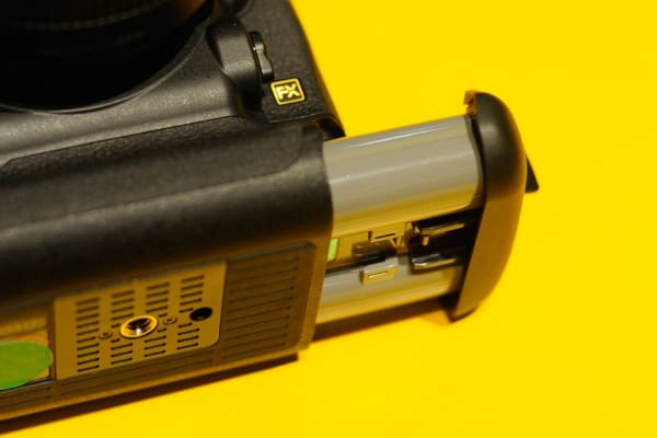 The Nikon D5 uses a pop-out battery that, like most pro DSLRs, offers excellent battery life.