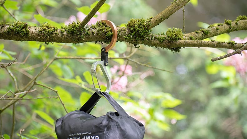clip holding bag attached to a tree limb