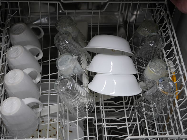 Dishes in a dishwasher.