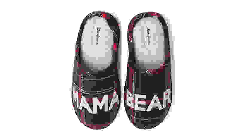 Cushy slippers with mama bear text on white background