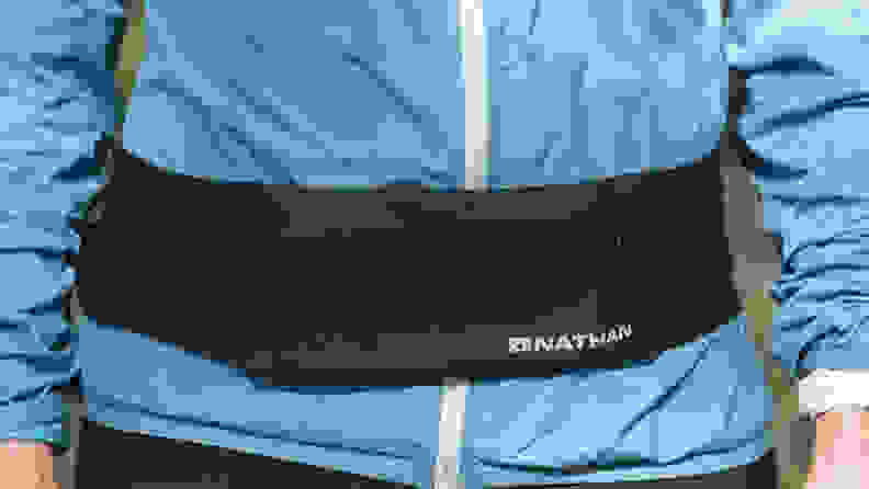 Person wearing Nathan Zipster running belt.