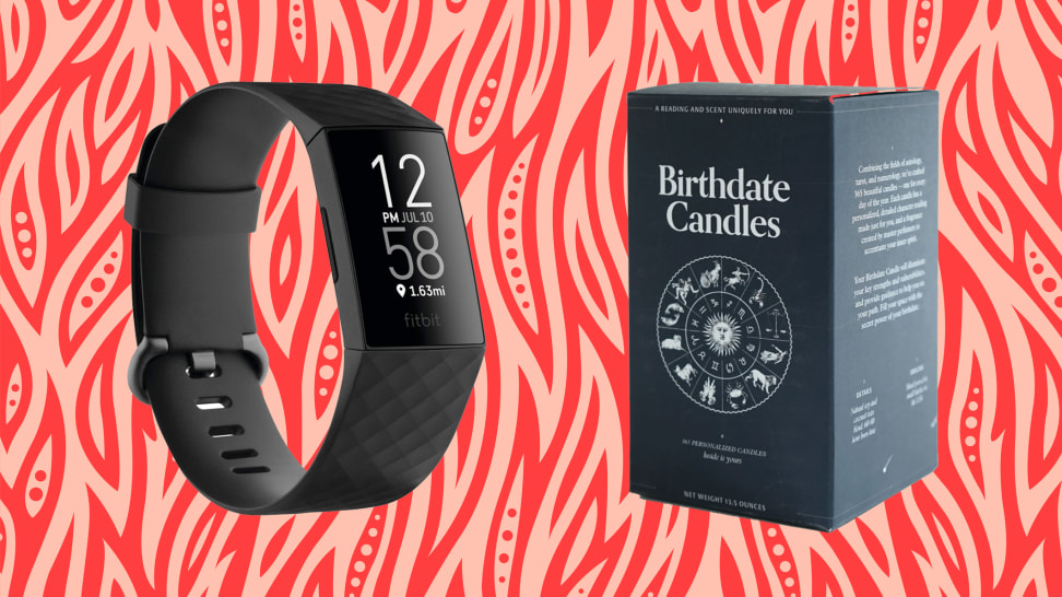 A Fitbit Charge 4 and Birthday Candle box against a red abstract background captures some of the best birthday gifts for Aries season.