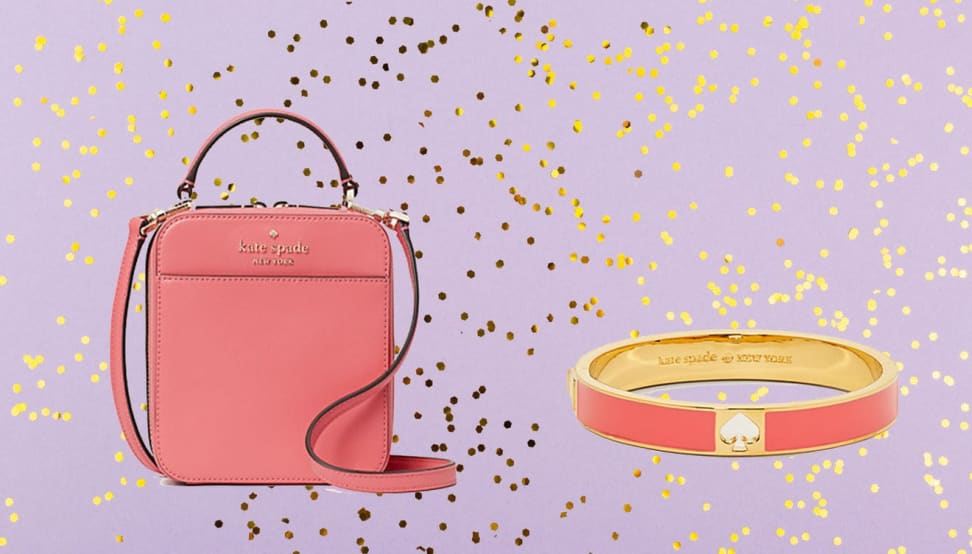 Pink Kate Spade bag and bracelet against a purple sparkly background