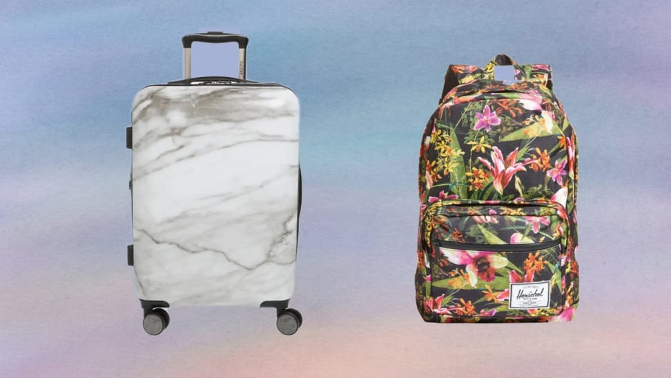 On left, gray and white marble rolling suitcase in front of purple background. On right, floral multicolored backpack in front of purple background.