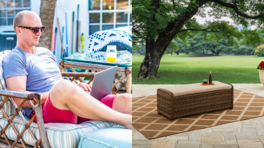 On right, man wearing sunglasses reclines in patio chair outside while working on laptop. On right, tan rectangular ottoman on top of tan and cream rug.