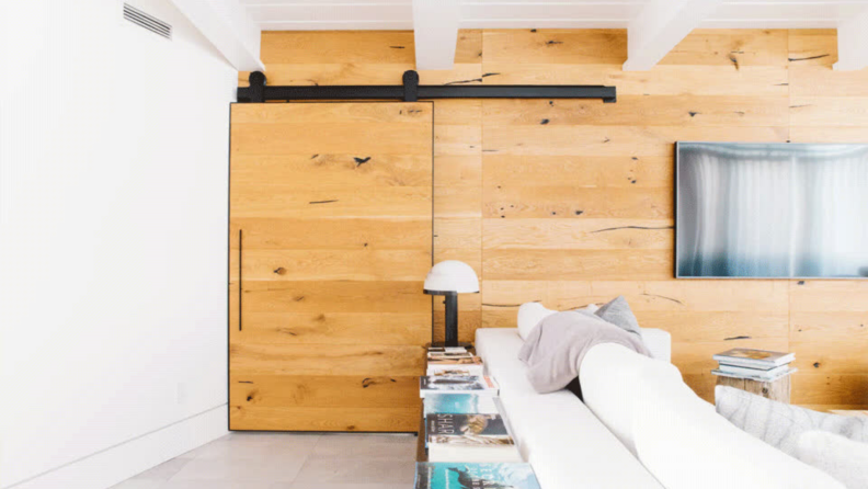 A sliding barn door easily opens and closes, hiding your mudroom from guests.