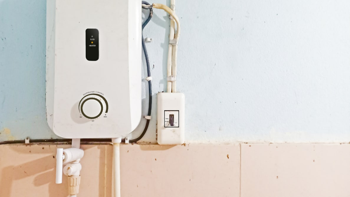 Tankless water heater connected to a wall.
