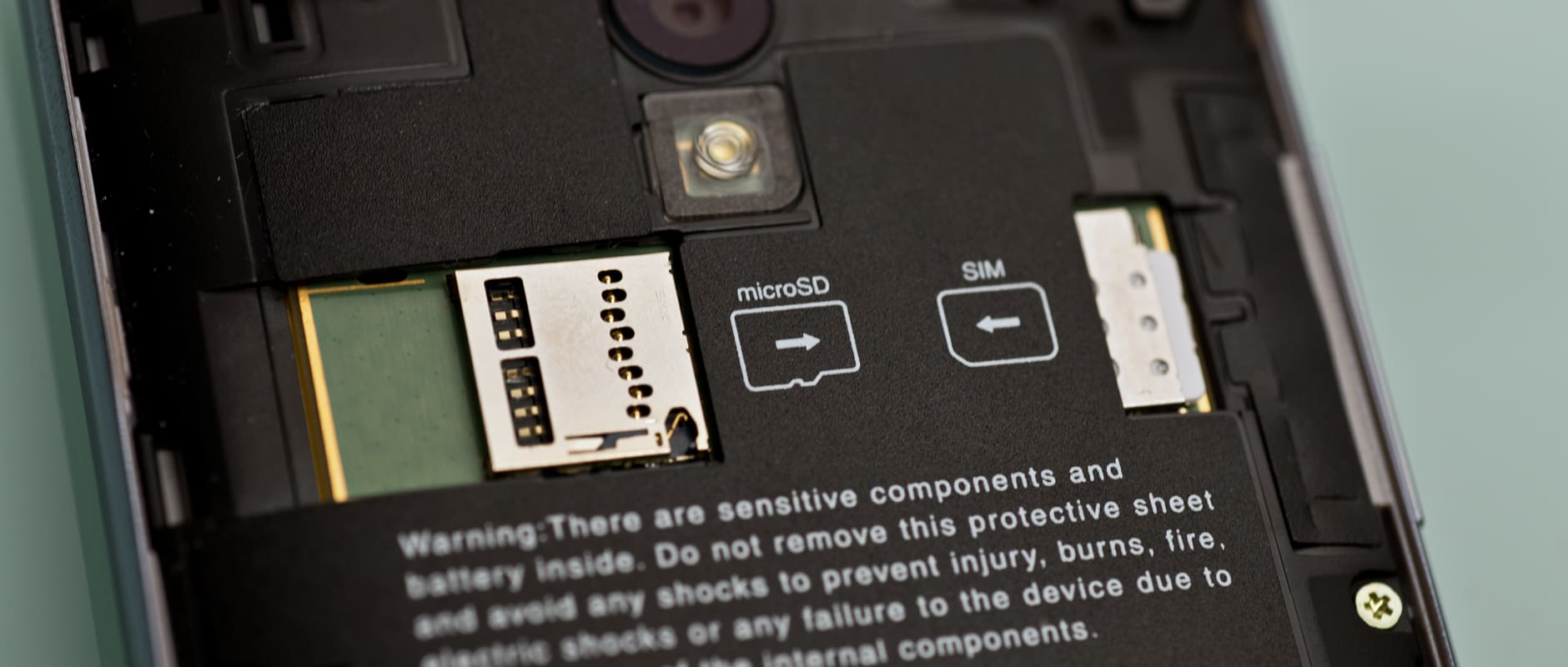 A photo of the Sharp Aquos Crystal's microSD card slot and SIM card slot.