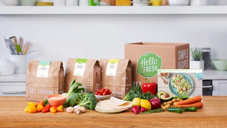 A box of HelloFresh meal kits arranged on a kitchen counter.