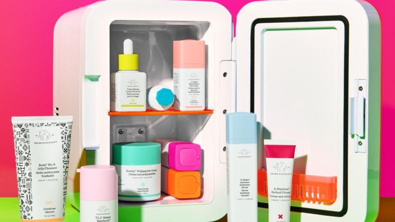 Stacks of Drunk Elephant skincare sit in a cosmetics mini fridge.