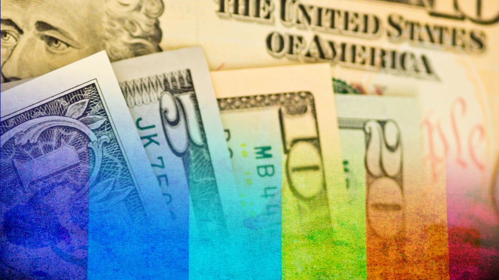 Dollar bills, a one-, five-, 10- and 20-dollar bill merged with a rainbow.