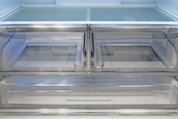 The Kenmore Elite 74033's Airtight Crisper is ideal for vegetables requiring a high moisture level, while the left drawer has a sliding knob to accommodate less demanding produce.