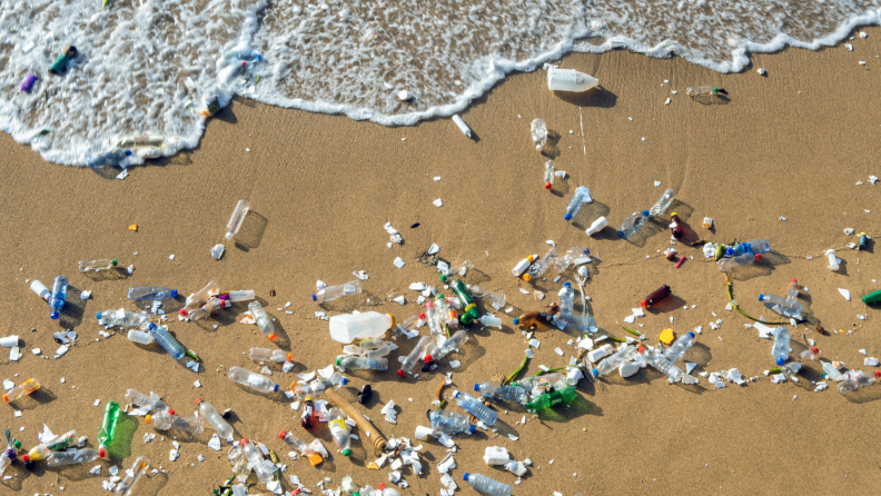 Plastic product littered all across the sand on the beach.