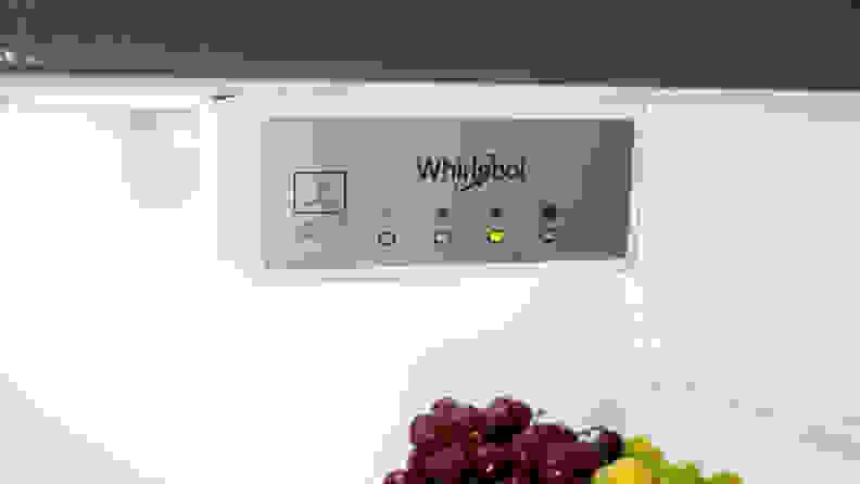 A close-up of the Whirlpool WRT518SZFM top-freezer fridge's temperature controls.