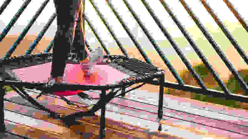 A close-up image of a person's feet while they use a mini rebounder.