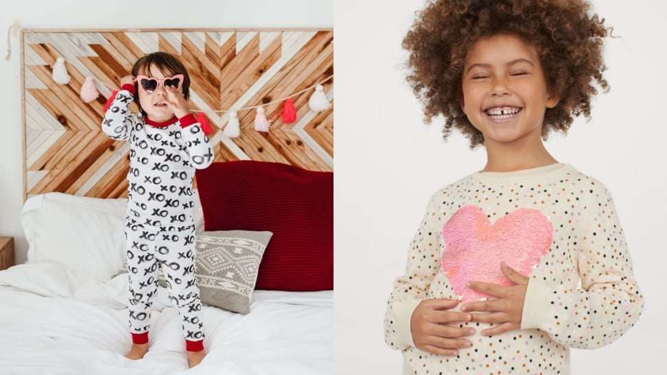 Gender neutral child in XO pajamas and Black girl in sequin motif-style sweater with a heart